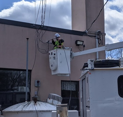 Technician installing new fiber at Lineham